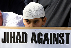 © Licensed to London News Pictures. 11/09/2011. London, UK. Radical Islamist group, Muslims Against Crusades, hold a protest outside the US Embassy in Grosvenor Square, London, on the 10th anniversary of the September 11th terrorist attacks on America. A counter-protest was held at the same time by the English Defence League. Photo credit : Joel Goodman/LNP