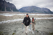 Liana and Parmenter Welty hike up a lateral moraine on the Kennicott Glacier side of Donoho Basin in Wrangell-St. Elias National Park, Alaska.