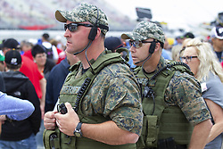 June 10, 2018 - Brooklyn, Michigan, U.S - Security keeps an eye on the fans on pit road at Michigan International Speedway. (Credit Image: © Scott Mapes via ZUMA Wire)