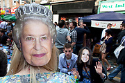 Her Majesty the Queen and Kate Middleton masks. Street party on Battersea High Street to celebrate the Royal Wedding of Prince William and Kate Middleton, April 29th 2011. Thousands attended this one of the largest street parties in London. Embracing the diversity of the community, the theme of the party is world food, dance and music, with live coverage of the royal Wedding aired on a giant screen.