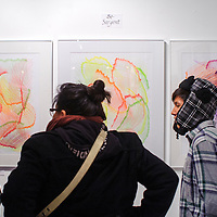 110814       Cable Hoover<br /> <br /> James Dennison, left, Chelsea Francis and Nathan Salaba look at work by Be Sargent in a show at Art123 Gallery during November ArtsCrawl in Gallup Saturday.