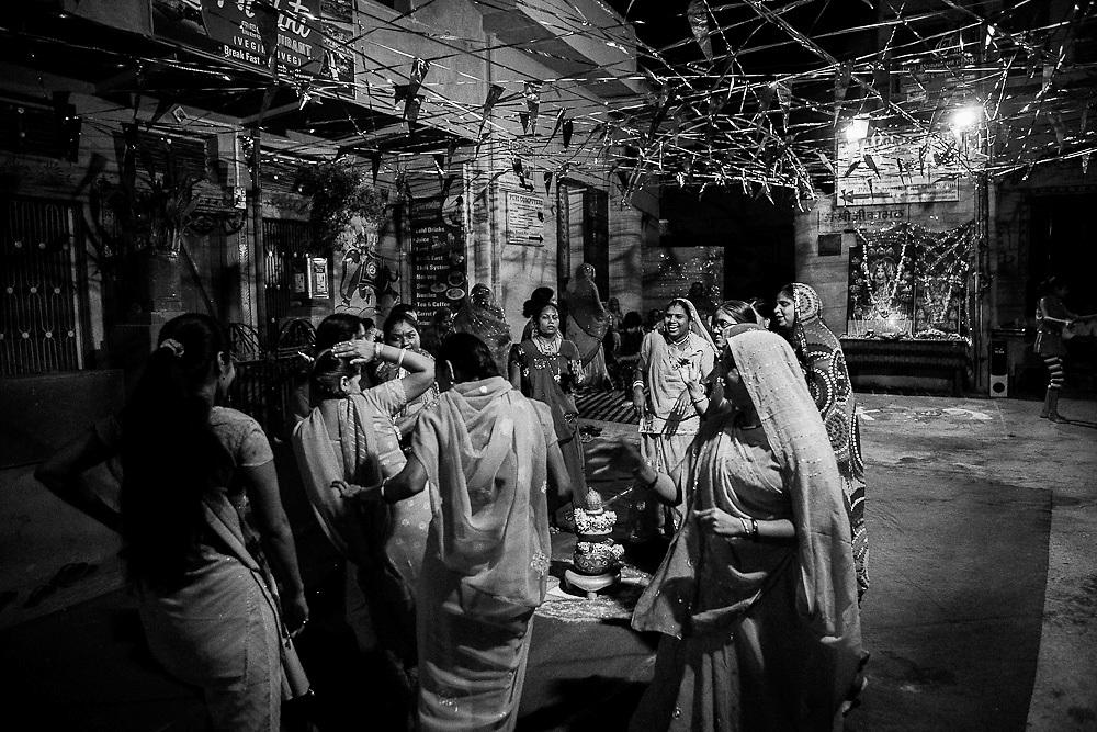 Indian women dancing for the Goddess Durga