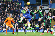 Nemanja Matic of Chelsea jumps to head the ball over Gianelli Imbula of Stoke City. Barclays Premier league match, Chelsea v Stoke city at Stamford Bridge in London on Saturday 5th March 2016.<br /> pic by John Patrick Fletcher, Andrew Orchard sports photography.