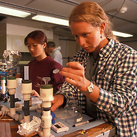 USA, Oceanography grad student works in biological research lab aboard R/V Thomas G. Thompson in North Pacific Ocean