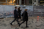 Businesspeople walk through rain under umbrellas on Lime Street in the City of London, the capitals financial district, 7th March 2018, in London England.