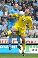 Photo: Ed Godden.<br />Coventry City v Leeds United. Coca Cola Championship. 16/09/2006. Robert Page (L) is challenged by Leed's Sean Gregan.
