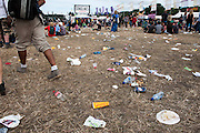 The rubbish continues to pile up and be trampled under foot as many people don't use the many bins provided and the festival motto of ;'Leave no Trace'. The 2013 Glastonbury Festival, Worthy Farm, Glastonbury. 30 June 2013. © Guy Bell, guy@gbphotos.com, all rights reserved