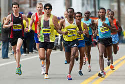 2013 Boston Marathon: Robin Watson, Canada, Jason   Hartmann, USA, Fernando Cabada, USA get caught by East African contingent of elite runners near mile 6