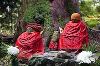 Red clad jizos at Okunoin,  considered one of the most sacred places in Japan. People from all over Japan, who wish to be buried close to Kobo Daishi, lie there, including former feudal lords, politicians and other prominent personalities. Their graves line the approaches to Okunoin for several hundred meters through the forest.