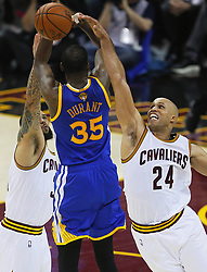 June 9, 2017 - Cleveland, OH, USA - The Cleveland Cavaliers' Richard Jefferson (24) and Deron Williams conspire to block a shot by the Golden State Warriors' Kevin Durant (35) in the third quarter during Game 4 of the NBA Finals at Quicken Loans Arena in Cleveland on Friday, June 9, 2017. The Cavs won, 137-116, trimming their series deficit to 3-1. (Credit Image: © Leah Klafczynski/TNS via ZUMA Wire)