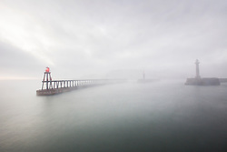 © Licensed to London News Pictures. 01/10/2015. Whitby, UK. Picture shows the entrance to Whitby harbour in this mornings fog. The fishing town of Whitby awoke to a thick covering of fog but the weather is due to brighten up later today. Photo credit: Andrew McCaren/LNP