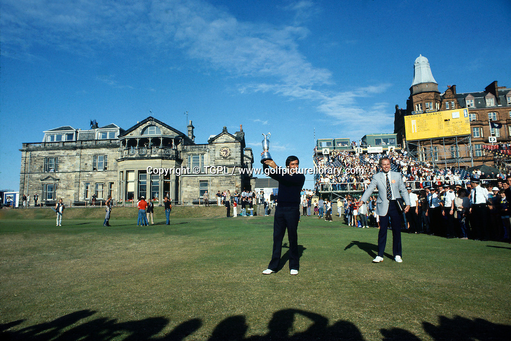 Seve BALLESTEROS (SPN) holds the famous Claret Jug aloft with the R&A clubhouse behind and the crowds clapping during fourth round Open Championship 1984,St.Andrews,Old Course, St.Andrews, Fife, Scotland.