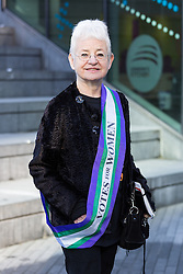 "© Licensed to London News Pictures. 08/03/2015. London, UK. Jacqueline Wilson at the ""Walk In Her Shoes"" event to mark International Women's Day at The Scoop amphitheatre on the south bank in London. Photo credit : Vickie Flores/LNP"