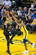 Golden State Warriors forward Andre Iguodala (9) defends the Milwaukee Bucks offense at Oracle Arena in Oakland, Calif., on March 29, 2018. (Stan Olszewski/Special to S.F. Examiner)