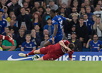 Football - 2018 / 2019 Premier League - Chelsea vs. Liverpool<br /> <br /> James Milner (Liverpool FC) slides in to bring down Victor Moses (Chelsea FC)  for which he received a yellow card at Stamford Bridge <br /> <br /> COLORSPORT/DANIEL BEARHAM