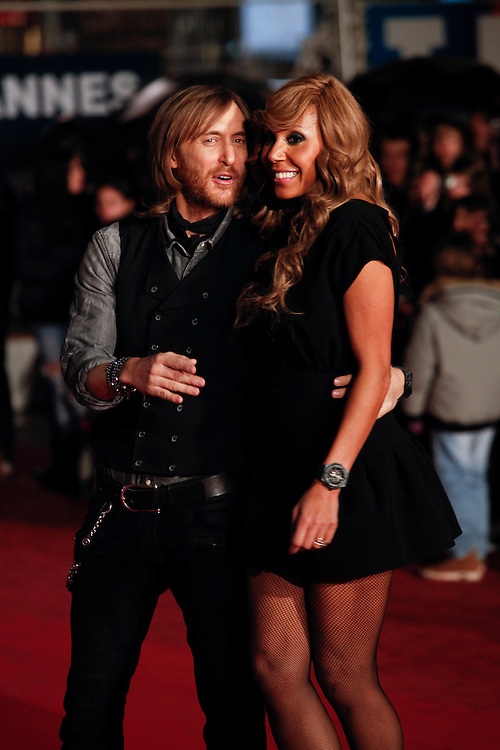 David and Cathy Guetta pose as they arrive at NRJ Music Awards 2012 at Palais des Festivals on January 28, 2012 in Cannes.David et Cathy Guetta posent à leur arrivée au NRJ Music 2012 Prix au Palais des Festivals le Janvier 28 2012 à Cannes.