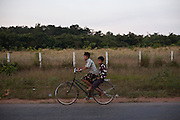 Young boys ride a bicycle, somewhere along the road between Yangon and Dawei, Burma.<br />