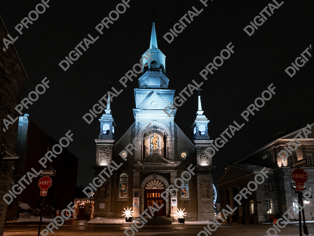Montreal, Quebec, Canada - January 3, 2021 Facade of Notre Dane de Bon Secour Chapel at night in Old Port of Montreal