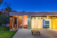 """CL20 Residence by Shubin+Donaldson Architects.<br /><br />How do you add on to a suburban home with minimal cost but maximum design impact?<br /><br />This is a question that most American homeowners face at some point, especially owners of post-war built tract and """"ranch style"""" homes. Our answer is the following:<br /><br />1. Pre-fab or modularize the construction as much as possible<br />2. Minimize impact on existing home and yard as much as possible<br />3. Maximize floor plan and wall adaptability<br />4. Maximize energy and resource efficiency<br />5. Use reclaimed construction materials where possible<br /><br />The 14 ft. x 34 ft.CL20 minimally connects to the existing house with a glass box connecting space. It deploys """"off the shelf"""" structural steel moment frames that bolt to a standard concrete slab on grade. These 4 frames support the flat roof thus providing all the vertical and lateral support necessary for the entire structure. This allows floor plan flexibility and eliminates exterior shear walls. The CL20 exterior walls are custom installed dual pane insulated glass and proprietary sliding doors. This transparent glass box minimizes visual impact on the yard while providing maximum interior day lighting.<br /><br />Resource Efficiency:<br /><br />The flat roof provides an excellent platform for a photovoltaic array to service the CL20 and existing residence. The interior walls and ceiling are reclaimed clear Douglas fir.<br /><br />All lighting is LED, and heating/cooling is provided by a high efficiency Mitsubishi split system. <br /><br />Text ©Shubin+Donaldson Architects, Inc.<br /><br />http://shubinanddonaldson.com/projects/cedar-lane/"""