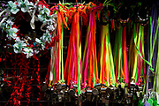 Notting Hill Carnival 2016 Childrens Day. Whistles and floral head garlands on sale.