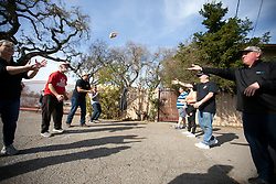 Contestants play pitch and catch with 12-ounce loaves of Spam at the 22nd annual Spam Festival, Sunday, Feb. 16, 2019, in Isleton, Calif. Spam lovers competed for prizes by presenting their favorite Spam-infused foods, or entering the Spam-eating and Spam-toss contests. (Photo by D. Ross Cameron)