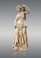 Anchyrrhoe Nymph - a 2nd century Roman sculpture from Iatly. The Anchyrrhoe Nymph is an allegory of Fortune and was desd in the gardens of the chateau d'Ecouen in the 17th century. The style is copied from a Hellanistic Greek original and also reprints the dance as a muse. Inv No. MR 310 (Usual No Ma 868), Louvre Museum, Paris.