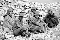 BURMA (MYANMAR) Yangon Division, Thanlyin, 2003. These rock breakers paused for only a moment during their punishingly difficult work. It is common to find women  and young men like these on road crews.