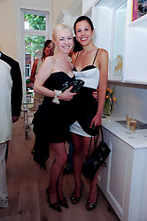 Left to right, LADY BIENVENIDA BUCK and ZOE GRIFFIN at a reception to celebrate the repairs on the Queen Elizabeth Gate in Hyde Park after it's successful repair following damaged sustained in a traffic accident in early 2010.  The party was held at 35 Sloane Gardens, London on 7th June 2010.