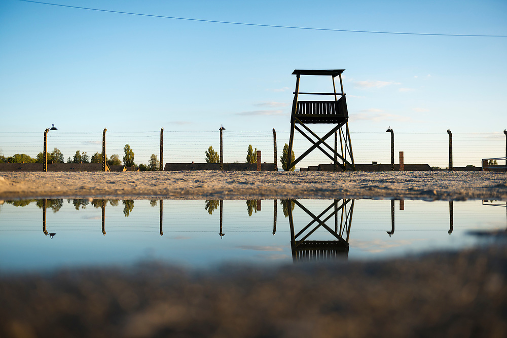 A guard tower at Auschwitz II-Birkenau, a former Nazi extermination camp and now a museum, is reflected in a puddle of rain in Oswiecim, Poland. This is the second of two camps built by the Germans at Auschwitz (Oswiecim) during World War II. The two camps are roughly two miles apart.