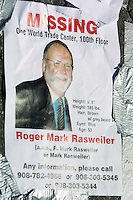 13 September 2001: Missing Person flyer of Roger Mark Rasweiler on the 100th floor of the One World Trade Center.  Thousands of people were missing following the Terrorist attack on the America's.  Lower Manhattan, NY. Area surrounding ground zero where the World Trade Centers WTC once stood only hours after they fell to the ground in New York.  Islamic terrorist Osama bin Laden declares The Jihad or Holy War against The United States of America on September 11, 2001. Headline news photos available for editorial use.