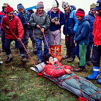 American guides teach climbing sherpas how to make a rescue sled at an early mountaineering school for sherpas in the Khumbu region of Nepal, 1980.