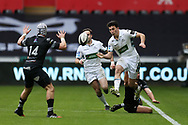 Leonardo Sarto of Glasgow Warriors looks to kick the ball over Hanno Dirksen of the Ospreys (14). Guinness Pro14 rugby match, Ospreys v Glasgow Warriors Rugby at the Liberty Stadium in Swansea, South Wales on Sunday 26th November 2017. <br /> pic by Andrew Orchard, Andrew Orchard sports photography.
