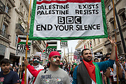 London, UK. Saturday 19th July 2014. Pro-Palestinian protesters in their tens of thousands march through central London to the Israeli Embassy in protest against the military offensive in Gaza by Israel. British citizens and British Palestinians gathered in huge numbers carrying placards and banners calling to 'Free Palestine' and to 'End the seige on Gaza'. BBC end your silence.