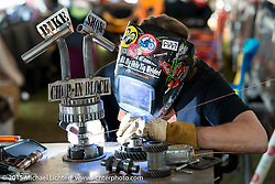 Austin Andrella welds the Chop In Block bike show award at the Cackleberry Campground during Daytona Beach Bike Week 2015. FL, USA. Wednesday, March 11, 2015.  Photography ©2015 Michael Lichter.