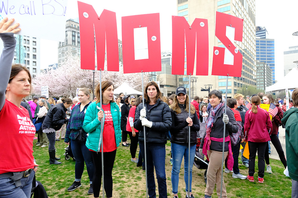 A group of Moms hold up a MOMS Sign during The March For Our Lives Demonstration in Nashville, TN on October 6, 2018