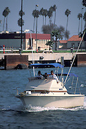 Cruising in recreational motor powerboat in channel, Port of Los Angeles, California