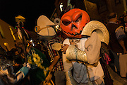 Costumed characters participate in a Comparsa or parade during the Day of the Dead Festival known in spanish as Día de Muertos on October 25, 2013 in Oaxaca, Mexico.
