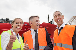 Happy business team at a harbour, Hamburg, Germany