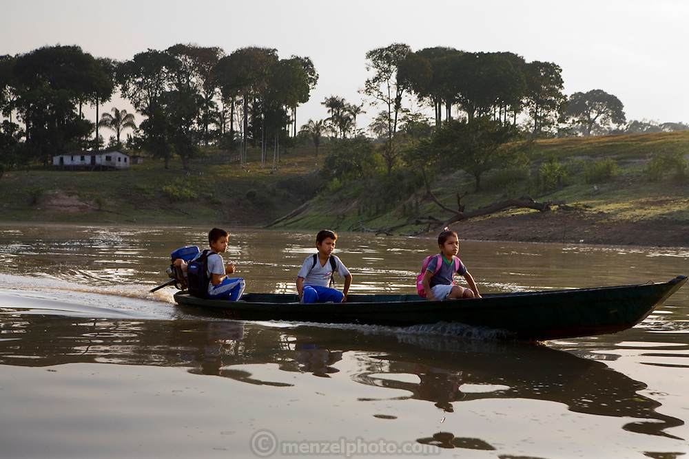 Solange and Francisco da Silva Correia's grandchildren use one of the family's outboard canoes to get to school in the nearby town of Caviana in Amazonia, Brazil, 20 minutes downriver.  (Solange Da Silva Correira is featured in the book What I Eat: Around the World in 80 Diets.)