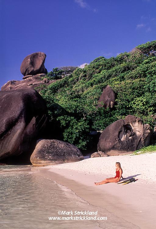 Snorkeler Suzy Forman relaxes on an idyllic beach at Ko Similan, Similan Islands Marine National Park, Thailand