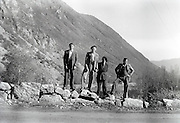 four friends posing with a mountain in the background Pyrenees France 1950s 1960s