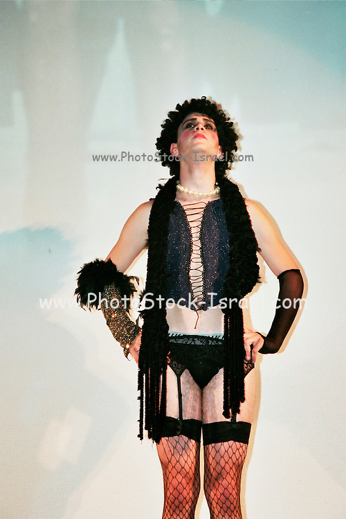 Dr. Frank-N-Furter originally played by Tim Curry, during a RHPS performance. The Rocky Horror Picture Show (RHPS) first released in the United Kingdom on 14 August 1975, is a science fiction-comedy-horror musical film directed by Jim Sharman from a screenplay by Sharman and Richard O'Brien, The film was based on O'Brien's long-running stage production The Rocky Horror Show.