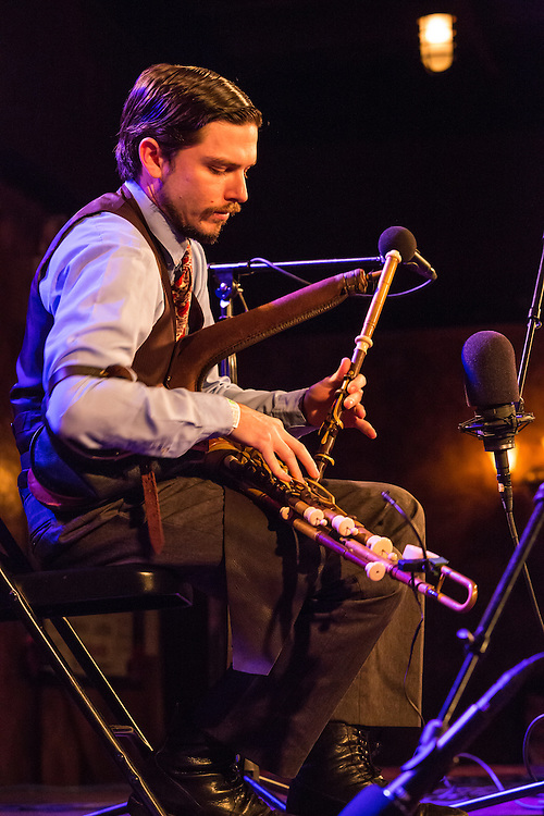 Joey Arbata plays the uilleann pipes, the traditional bagpipe of Ireland. Uilleann pipes are powered by a bellows.