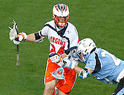 Virginia Cavaliers Ron Emery (24) is defended by Johns Hopkins Rob Guida (27) during the game in Charlottesville, VA. Johns Hopkins defeated Virginia 11-10 in overtime.Photo/Andrew Shurtleff