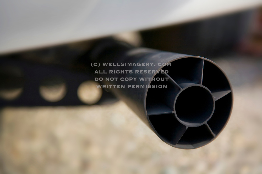 Image detail of the exhaust tip megaphone muffler on the Rolly Resos 1966 Porsche 911 R Gruppe Hot Rod ex-rally car in Cambria, California, America West, property released by Randy Wells
