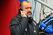 Wolverhampton Wanderers manager Nuno Espirito Santo on the phone before the The FA Cup 5th round match between Bristol City and Wolverhampton Wanderers at Ashton Gate, Bristol, England on 17 February 2019.
