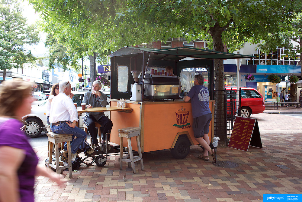 A street scene in Trafalgar Street, Nelson, showing people at mobile food and drink vendors on street corners, Nelson, New Zealand, 1st February 2011, Photo Tim Clayton.