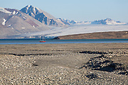 Polish sailboat the Eltanin anchored in remote Josephbukta, Svalbard with Recherchebreen in the background. The yacht sails from Poland to Svalbard every summer to provide transportation to researchers and tourists.