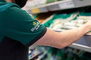 A uniformed member of staff sorts through fresh produce in British supermarket chain Morrisons on 23rd August, 2021 in Leeds, United Kingdom. British supermarket chain Morrisons, which employs over 110,000 staff across its 500 shops, has accepted a £6.3bn $8.7bn takeover bid from US private equity firm Fortress Investment Group.