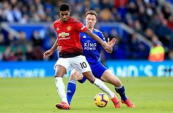 Manchester United's Marcus Rashford (left) and Leicester City's Jonny Evans battle for the ball during the Premier League match at the King Power Stadium, Leicester.